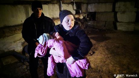 Frightened family in Ukraine basement (Photo: Filip Warwick)