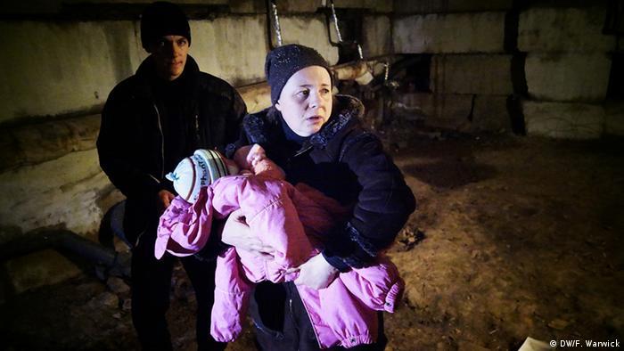 Frightened family in Ukraine basement (Photo: Filip Warwick)