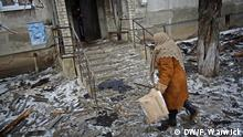 Name of the photographer/source: DW/Filip Warwick Date the pic was taken? January 2015 Where was the pic taken: Ukraine Popasna is one of many Ukrainian frontline towns. A morning rocket strike had damaged a section of the residential block of flats.