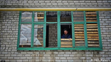 Man boarding up window in Ukraine (Photo: Filip Warwick)