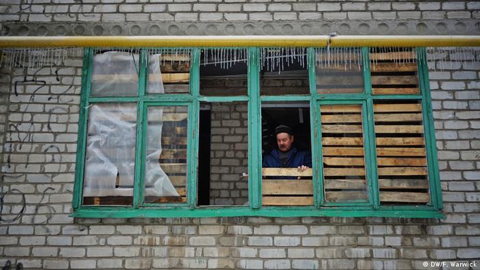Man boarding up window in Ukraine (Photo: Filip Warwick)
