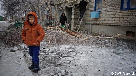 Ukrainian child standing in the cold (Photo: Filip Warwick)