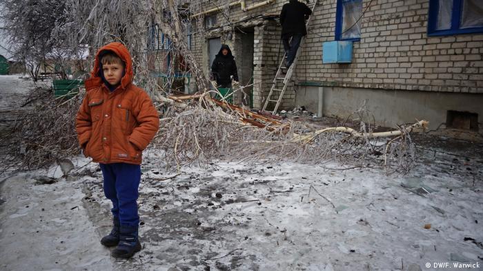 Ukrainian child standing in the cold (Photo: Filip Warwick)