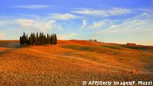 A view of the Crete Senesi landscapes taken on August 14, 2013 at the sunset in Siena countryside. AFP PHOTO/ FABIO MUZZI (Photo credit should read FABIO MUZZI/AFP/Getty Images)