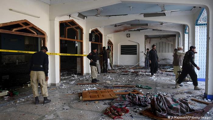 Pakistani security personnel inspect a Shiite Muslim mosque after an attack by Taliban militants in Peshawar on February 13, 2015.