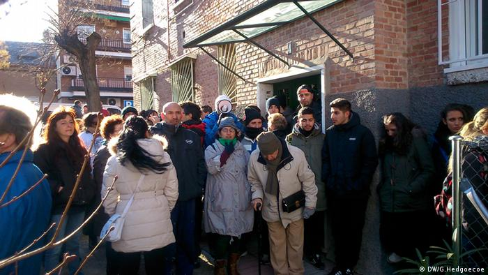 Activists block entry to a residential building in Madrid
