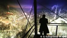 13.02.2015 DRESDEN, GERMANY - FEBRUARY 13: A visitor stands in front of a 360 degree panorama display by artist Yadegar Asisi that depicts the city of Dresden in the aftermath of the February 13, 1945 Allied firebombing on February 13, 2015 in Dresden, Germany. The city of Dresden is commemorating the 70th anniversary of the bombing today with a series of events that includes the formation of a human chain tonight across the city center. On February 13-14, 1945, U.S. and British bombers attacked in successive raids that devastated the city and killed at least 25,000 people. (Photo by Sean Gallup/Getty Images)