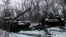 Pro-Russian separatists stand next to tanks on the outskirts of Horlivka, eastern Ukraine February 10, 2015. At the front in Vuhlehirsk, a small town captured by rebels last week, volleys of artillery crashed in both directions. The rebels are pushing to encircle government forces holding out in nearby Debaltseve, a rail hub that is the main rebel target. REUTERS/Maxim Shemetov (UKRAINE - Tags: POLITICS CIVIL UNREST CONFLICT TRANSPORT MILITARY)