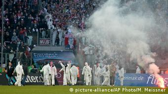 Cologne fans on pitch.