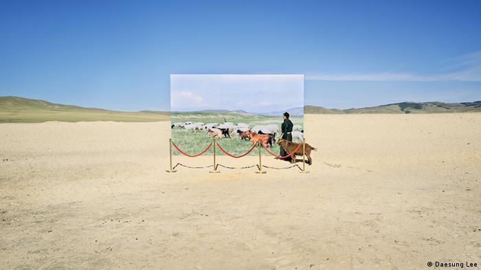 A life-size canvas of animals in a desert landscape