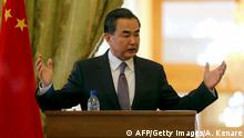 15.02.2015 Chinese Foreign Minister Wang Yi holds a press conference with his Iranian counterpart Mohammad Javad Zarif following a meeting on February 15, 2015 in the capital Tehran. Wang Yi began a two-day official visit to Iran, where he is expected to address ongoing talks over Tehran's nuclear programme. AFP PHOTO / ATTA KENARE (Photo credit should read ATTA KENARE/AFP/Getty Images)