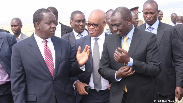 Fred Matiangi, Kenya's Information Cabinet Secretary talks to Deputy President William Ruto