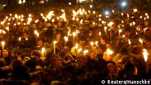 16.2.2015 People hold candles during a memorial service is held for those killed on Saturday by a 22-year-old gunman, in Copenhagen February 16, 2015. Danish police said on Monday they had charged two people with aiding the man suspected of shooting dead two people in attacks on a synagogue and an event promoting free speech in Copenhagen at the weekend. The shootings, which Danish Prime Minister Helle Thorning-Schmidt called acts of terrorism, sent shockwaves through Denmark and have been compared to the January attacks in Paris by Islamist militants that killed 17. REUTERS/Hannibal Hanschke (DENMARK - Tags: CRIME LAW POLITICS RELIGION CIVIL UNREST)