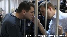 MOSCOW, RUSSIA. DECEMBER 30, 2014. Russian opposition leader Alexei Navalny (R) and his brother Oleg Navalny appear at Moscow's Zamoskvoretsky District Court for the announcement of a verdict in the Yves Rocher fraud case. The Navalny brothers are charged with embezzling more than 26 million rubles from Yves Rocher Vostok cosmetics company. The court gives Alexei Navalny a suspended jail term of three and a half years and Oleg Navalny has been sentenced to three and a half years in prison colony. Artyom Korotayev/TASS