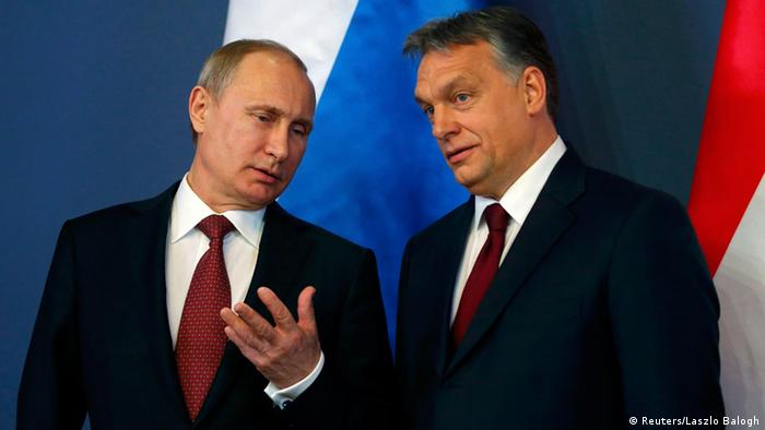 Putin gestures to Orban before a press conference in Budapest (Reuters/Laszlo Balogh)