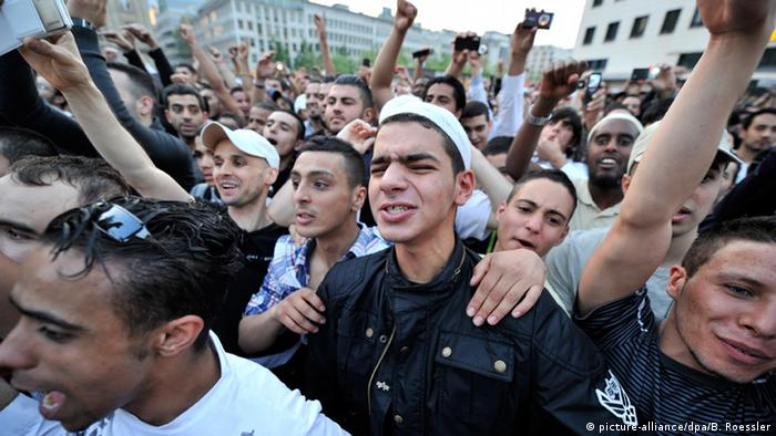 Photo: Young men cheering in a crowd