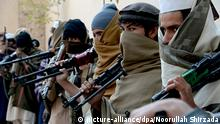 Afghan former Taliban fighters are photographed holding weapons before they hand them over as part of a government peace and reconciliation process at a ceremony in Jalalabad on February 8, 2015. Over twenty former Taliban fighters from Achin district of Nangarhar province handed over weapons as part of a peace reconciliation program. AFP PHOTO / Noorullah Shirzada (Photo credit should read Noorullah Shirzada/AFP/Getty Images)
