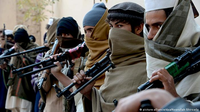 Former Taliban fighters are photographed holding weapons before they hand them over as part of a government peace and reconciliation process at a ceremony in Jalalabad on February 8, 2015 (Photo: Noorullah Shirzada/AFP/Getty Images)