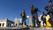 19.02.2015 * Police troopers secure the gate of a hotel hosting U.N.-sponsored negotiations on a political settlement for Yemen's crisis, in Sanaa February 19, 2015. Yemen is slipping further into chaos as the Houthis, an Iranian-backed Shi'ite Muslim militia from the north, consolidate their grip on power after seizing the capital in September and sidelining the central government. REUTERS/Khaled Abdullah (YEMEN - Tags: POLITICS CONFLICT CIVIL UNREST)