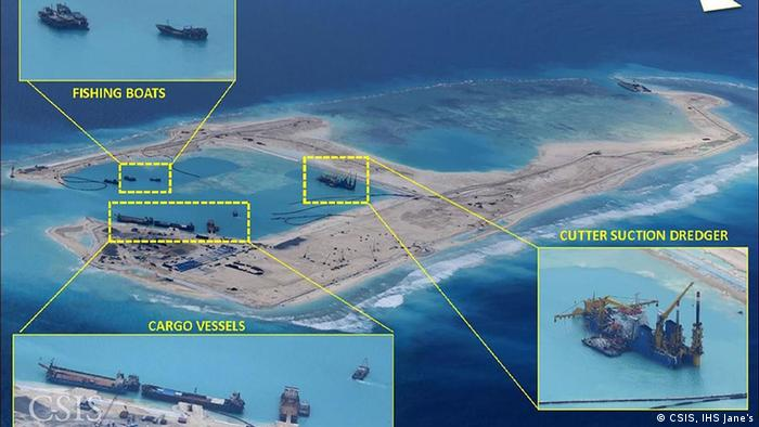 Chinese vessels ae seen building up the Fiery Cross reef in the South China Sea in February 2015