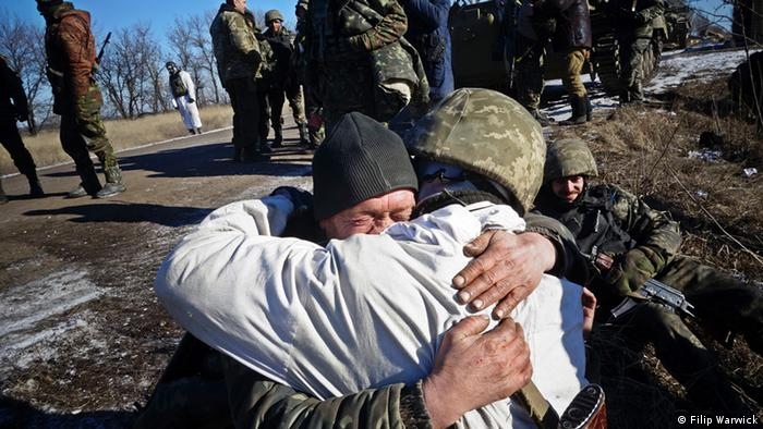 Two soldiers hug
