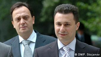 Prime Minister Gruevski in the foreground, former secret services chief Saso Mijalkov is stood behind him.