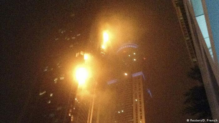 A fire blazes at The Torch, a residential high-rise tower, in Dubai February 21, 2015. Hundreds of people were evacuated from one of the world's tallest residential buildings on Saturday when fire swept through the more than 330-metre (1,082-foot) tall skyscraper The Torch in Dubai, residents said. Authorities had no immediate word on the cause of the fire. REUTERS/David French