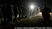 21.02.2015 Ukrainian prisoners of war prepare to march before a prisoner exchange in separatist controlled territory, near Zholobok, Ukraine, Saturday, Feb. 21, 2015. Ukrainian military and separatist representatives exchanged dozens of prisoners under cover of darkness at a remote frontline location Saturday evening. 139 Ukrainian troops and 52 rebels were exchanged, according to a separatist official overseeing the prisoner swap at a no man¿s land location near the village of Zholobok, some 20 kilometers (12 miles) west of Luhansk. (AP Photo/Vadim Ghirda)