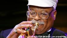 Jazz musician Clark Terry performs to celebrate the 20th anniversary of the Thelonious Monk Institute of Jazz in the East Room of the White House in Washington in this September 14, 2006 file photo. Terry, a Grammy award-winning trumpet player and composer who recorded with greats such as Billie Holiday, Ella Fitzgerald and Quincy Jones, has died aged 94, his wife said on February 22, 2015. REUTERS/Kevin Lamarque/Files (UNITED STATES - Tags: ENTERTAINMENT PROFILE OBITUARY)