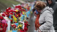 22.02.2015 KIEV, UKRAINE - FEBRUARY 22: A woman weeps at a memorial to victims of the Maidan uprising prior to the 'March of Diginity' and ceremonies marking the first anniversary of the Maidan revolution that led to the ouster of Ukrainian President Viktor Yanukovich one year ago at Maidan Independence Square on February 22, 2015 in Kiev, Ukraine. Meanwhile Ukrainian government forces and pro-Russian separatists have exchanged prisoners in a hopeful sign that the recent Minsk ceasefire agreements might still have a chance. (Photo by Sean Gallup/Getty Images)