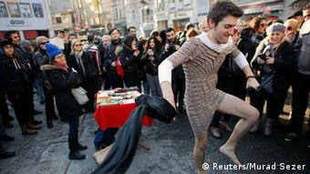 Men wearing miniskirts in protest of the murder of Ozgecan Aslan
