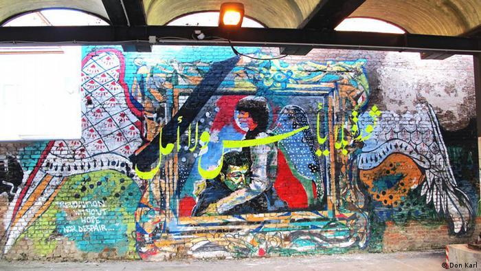 Sebuah lukisan di tembok Berlin