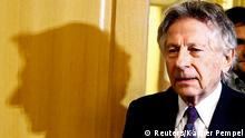 Filmmaker Roman Polanski arrives for a court hearing in Krakow February 25, 2015. Polanski appeared in a Polish court on Wednesday at a hearing to consider a U.S. request for his extradition over a 1977 child sex crime conviction. REUTERS/Kacper Pempel (POLAND - Tags: CRIME LAW ENTERTAINMENT TPX IMAGES OF THE DAY)