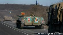 260215 Military vehicles of the Ukrainian armed forces are seen near Artemivsk, eastern Ukraine, February 25, 2015. Ukraine's military said on Wednesday none of its troops had been killed at the front in the last 24 hours and only one had been wounded, with a spokesman describing it as the first day with no fatalities in at least several weeks. REUTERS/Gleb Garanich (UKRAINE - Tags: POLITICS CIVIL UNREST MILITARY CONFLICT TPX IMAGES OF THE DAY) TEMPLATE OUT