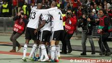 26.02.2015 Tolgay Arslan of Besiktas (covered) celebrates with team mates after scoring a goal against Liverpool during their Europa League round of 32 second leg soccer match in Istanbul February 26, 2015. REUTERS/Osman Orsal (TURKEY - Tags: SPORT SOCCER)