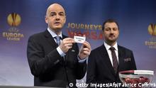 UEFA General Secretary Gianni Infantino presents the name Vfl Wolfsburg during the draw for the UEFA Europa League round of 32 on December 15, 2014 at the UEFA headquarters in Nyon. AFP PHOTO / FABRICE COFFRINI (Photo credit should read FABRICE COFFRINI/AFP/Getty Images)