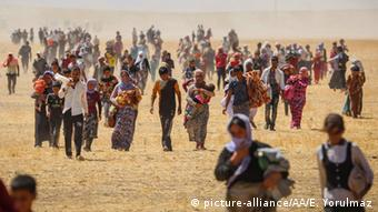 Yezidis fleeing Sinjar after IS took control of the area in August 2014.