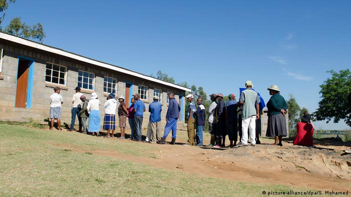People in Lesotho line up outside a polling station