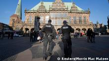 Armed police officers patrol in front of the town hall of the northern German city of Bremen, February 28, 2015. Police in the Bremen warned on Saturday of an unspecified potential danger from Islamist extremists in the city and said they were increasing security measures. REUTERS/Morris Mac Matzen (GERMANY - Tags: CIVIL UNREST)