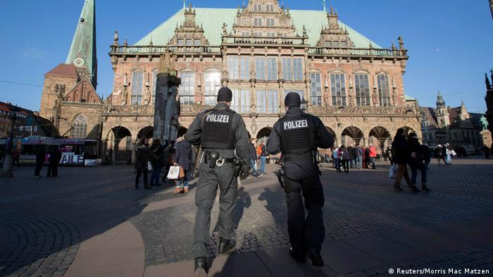 Armed police officers patrol in front of the town hall of the northern German city of Bremen, February 28, 2015. REUTERS/Morris Mac Matzen