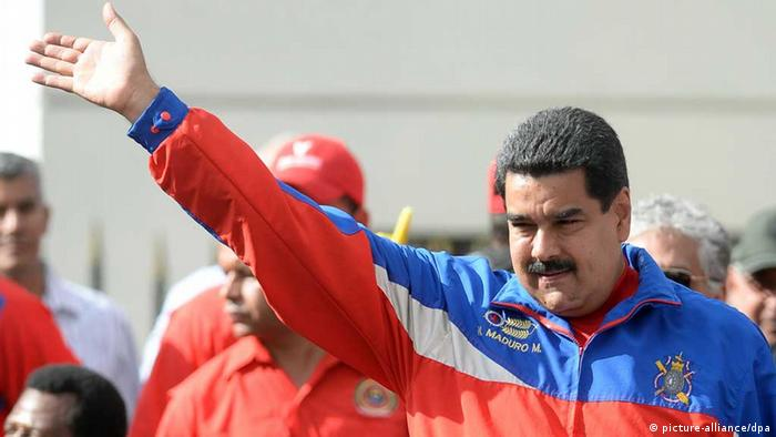 Venezuelan President Nicolas Maduro waves to supporters during a march