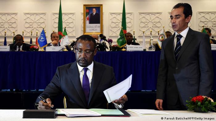 Malian Foreign Minister Abdoulaye Diop signs the peace agreement in Algiers. Photo: FAROUK BATICHE/AFP/Getty Images