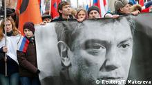 People hold a banner of Kremlin critic Boris Nemtsov, who was shot dead on Friday night, during a march to commemorate him in central Moscow March 1, 2015. Opposition supporters march through Moscow on March 1 in memory of Nemtsov, whose murder has increased concern about Russia's future among opponents of President Vladimir Putin. REUTERS/Tatyana Makeyeva (RUSSIA - Tags: CRIME LAW POLITICS CIVIL UNREST)