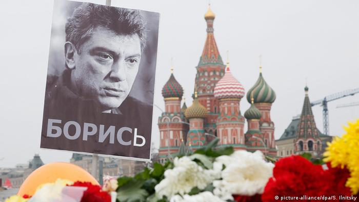 A portrait of murdered Russian opposition veteran leader Boris Nemtsov above flowers tributed in his memory at the site of his killing, with St. Basil's Cathedral seen in the background, in central Moscow, Russia, 02 March 2015.
