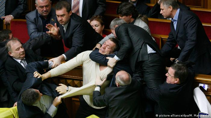 Ukrainian parliamentarians fight in the Parliament's hall in Kiev