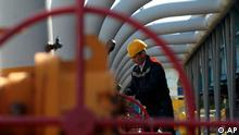 A Ukrainian worker operates valves in a gas storage point in Bil 'che-Volicko-Ugerske underground gas storage facilities in Strij, outside Lviv, Ukraine, Wednesday, May 21, 2014. (AP Photo/Sergei Chuzavkov)