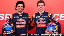JEREZ DE LA FRONTERA, SPAIN - JANUARY 31: Max Verstappen of Netherlands and Scuderia Toro Rosso and Carlos Sainz Jr of Spain and Scuderia Toro Rosso pose with the new STR10 outside the team garage during previews ahead of Formula One Winter Testing at Circuito de Jerez on January 31, 2015 in Jerez de la Frontera, Spain. (Photo by Mark Thompson/Getty Images)