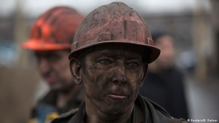 A miner waits for a bus after leaving Zasyadko coal mine in Donetsk March 4, 2015.