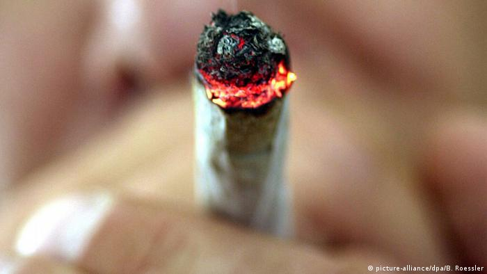 An archive image showing a close-up of someone smoking a marijuana cigarette
