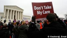 4.3.2015 Demonstrators in favor of Obamacare gather at the Supreme Court building in Washington March 4, 2015. The U.S. Supreme Court will consider on Wednesday a second major legal attack on President Barack Obama's healthcare law, with conservative challengers taking aim at a pivotal part of the statute that authorizes tax subsidies to help people afford insurance. REUTERS/Jonathan Ernst (UNITED STATES - Tags: POLITICS HEALTH CIVIL UNREST)